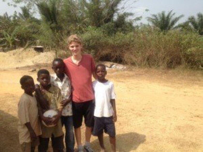Cosy Burnett with children in Ghana.