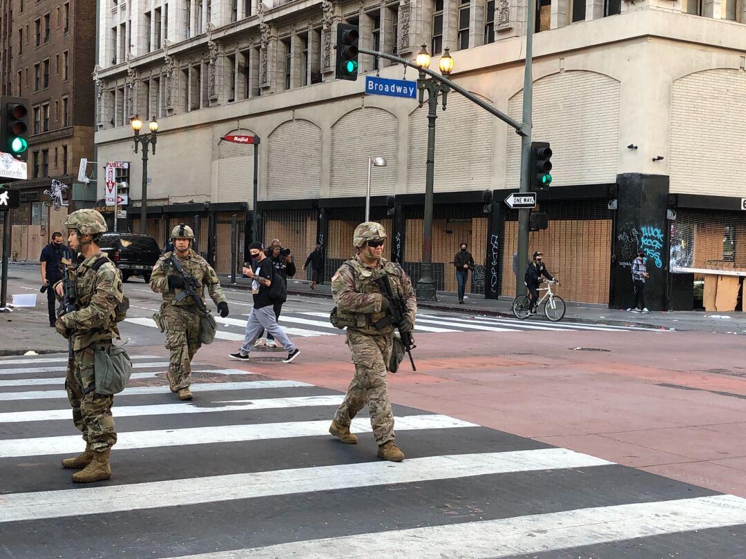 National Guardsmen patrol downtown Los Angeles on Sunday morning.