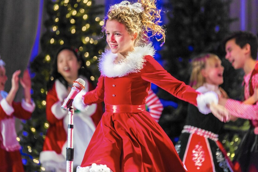 "Fina Strazza, 10, stars in the Hallmark movie ""A Christmas Melody,"" directed by Mariah Carey."