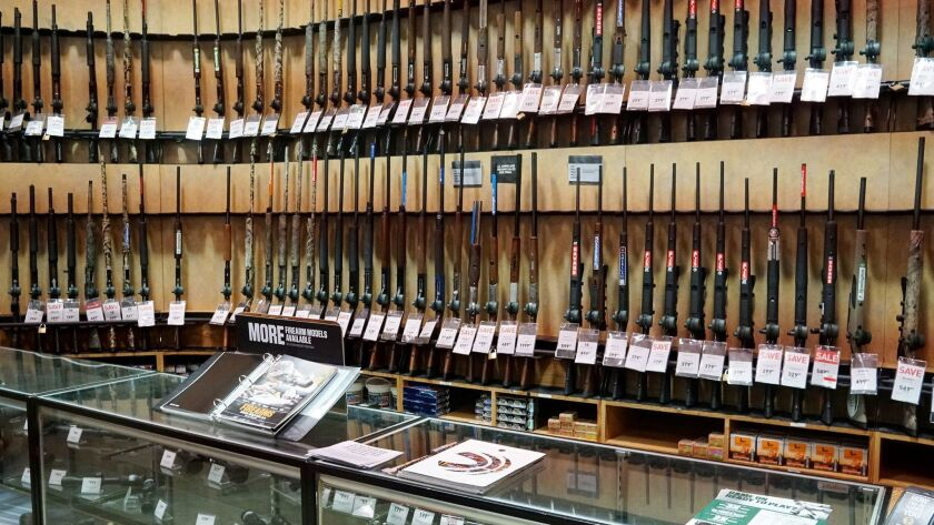 The gun department in a Dick's Sporting Goods store in Arlington, Va., is filled with long guns on March 1.