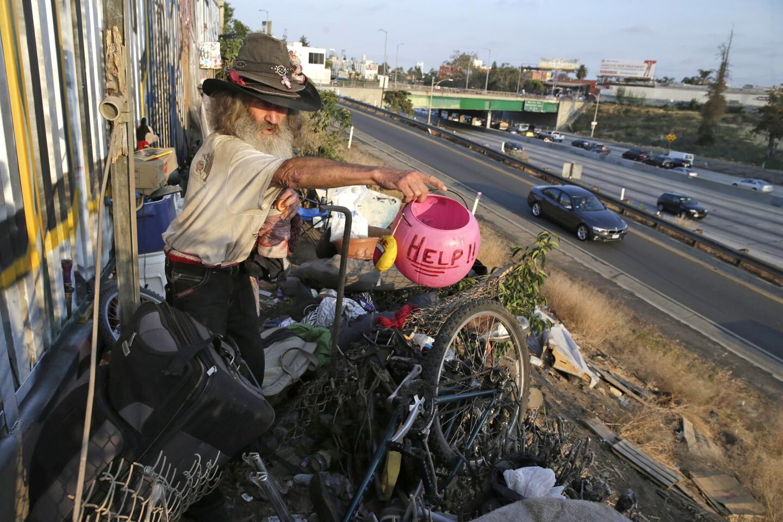 Randé Zell lives in an encampment along the 101 Freeway near the Fountain Avenue overpass.