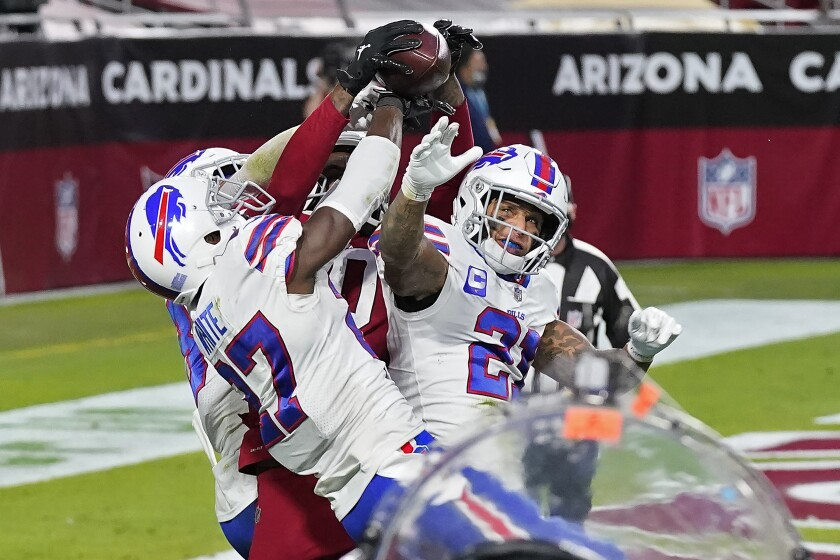 Arizona Cardinals wide receiver DeAndre Hopkins catches the game-winning touchdown as Buffalo Bills cornerback Tre'Davious White (27), free safety Jordan Poyer (21) and strong safety Micah Hyde, left, defend during the second half of an NFL football game, Sunday, Nov. 15, 2020, in Glendale, Ariz. The Cardinals won 32-20. (AP Photo/Ross D. Franklin)