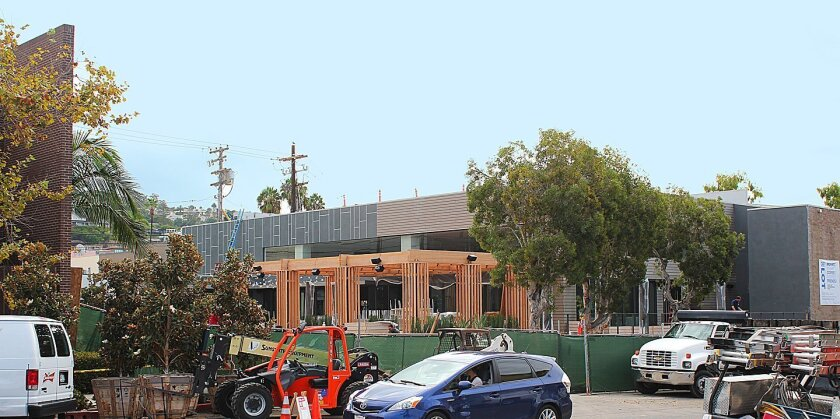 Site superintendent Charlie D'Amato, of Dempsey Construction, said at times there were upwards of 150 people per day working to finish The Lot cinema complex, as seen under construction Sept. 16, 2015 at 7611 Fay Ave., former site of Jonathan's Market in La Jolla.
