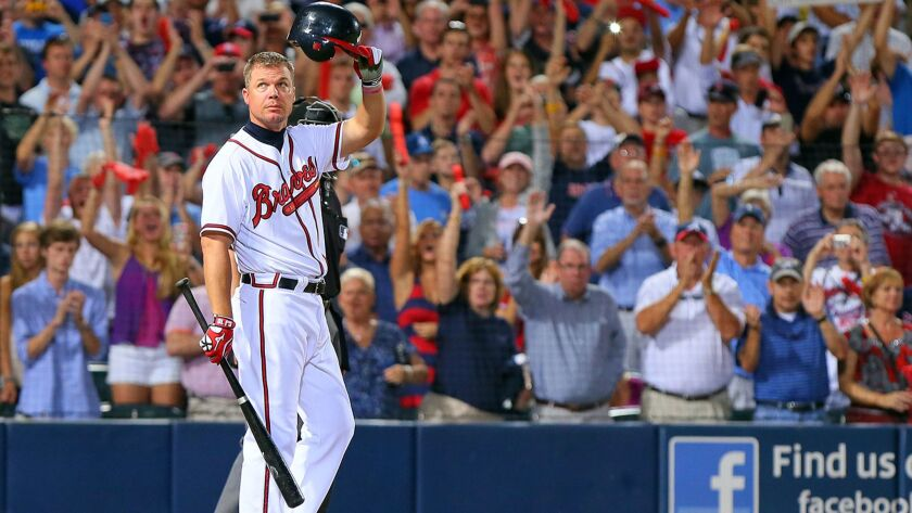 The Atlanta Braves' Chipper Jones tips his cap to the crowd as he takes the plate for the last at-bat of his career during at National League Wild Card game against the St. Louis Cardinals at Turner Field in Atlanta, Georgia, Friday, October 5, 2012.
