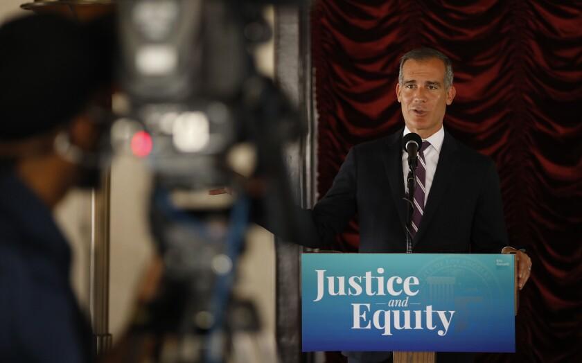 Mayor Eric Garcetti speaks at a lectern