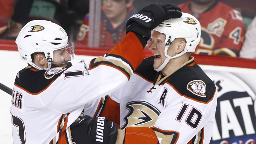 Ducks forward Corey Perry, right, celebrates his goal against the Calgary Flames with Ryan Kesler during overtime.