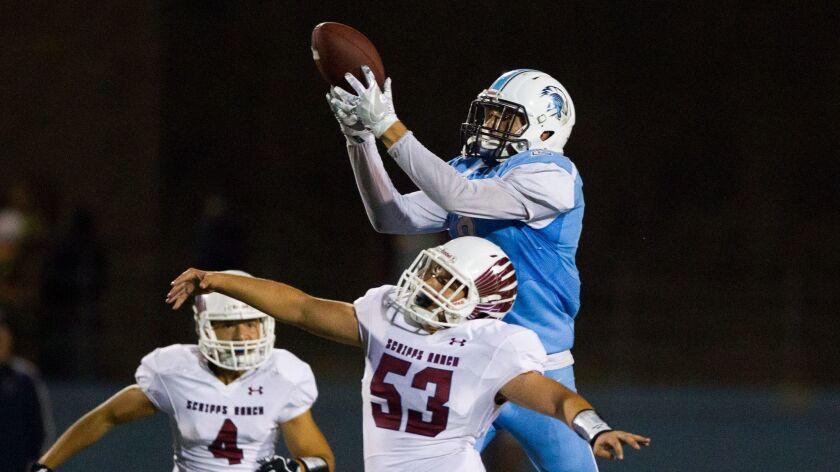 University City wide receiver Casey Granfors makes a catch over top of linebacker Daniel Sanders.
