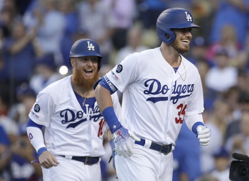 Cody Bellinger, right, celebrates with teammate Justin Turner.