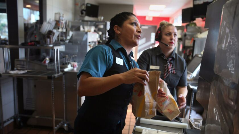 Miriam Medina, left, general manager at a fast-food restaurant in Clairemont, is a recipient of the u-visa, having been the victim of domestic violence.