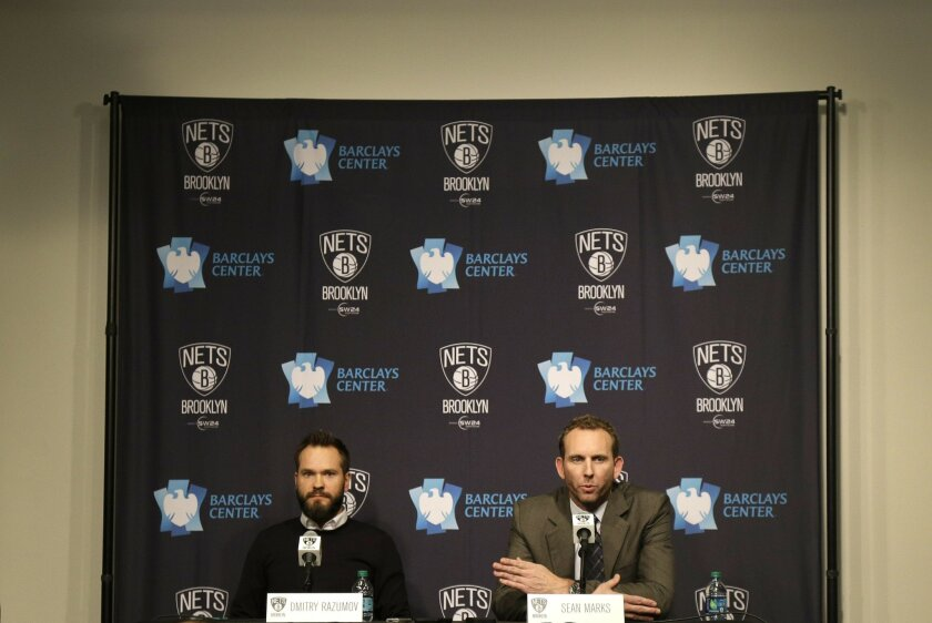 Sean Marks, right, answers questions during a news conference where he was introduced as the new general manager of the Brooklyn Nets, before the Nets' NBA basketball game against the New York Knicks, Friday, Feb. 19, 2016, in New York. Dmitry Razumov, chairman of the board of directors for the tea
