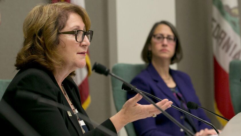 Assemblywoman Eloise Gomez Reyes (D-Grand Terrace), left, asks a question during a hearing about the chamber's policies concerning sexual harassment as Assemblywoman Laura Friedman (D-Glendale) listens.