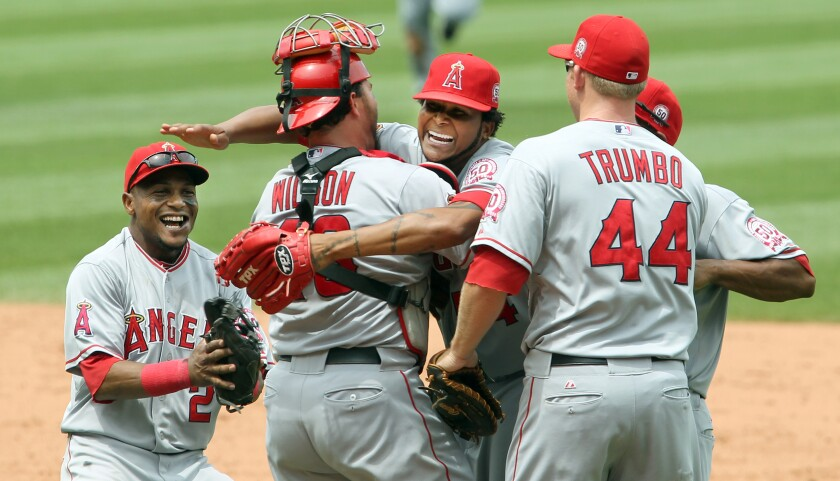 Angels pitcher Ervin Santana hugs catcher Bobby Wilson and celebrates with teammates after throwing a no-hitter.