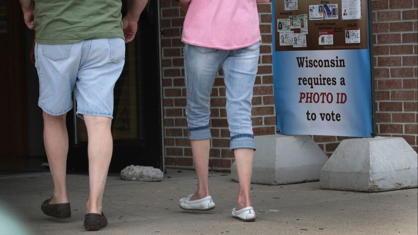 A sign reminding Wisconsin voters that ID is required for the Aug. 14, 2018, primary.
