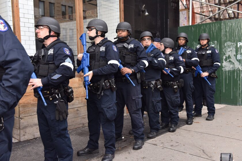 New York police line up near an abandoned subway station in a lower Manhattan to stage a drill simulating a terrorist attack Sunday, Nov. 22, 2015, in New York. Following the Nov. 13 terror attack in Paris and four days before New York's Macy's Thanksgiving Day Parade, emergency responders from the New York Police Department, Fire Department of New York and Homeland Security participated in the drill. (New York Police Department via AP)