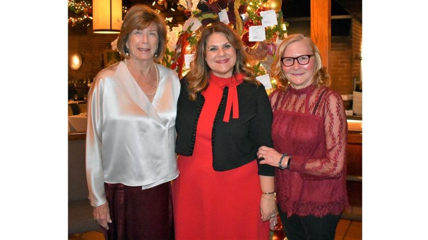 Donna De Mond, left, chair of the Hillside party, is shown with Carrie Espinoza and Patty McAllister