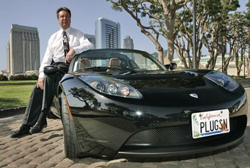 Gregg Neuman of San Diego picked up his electric Tesla Roadster in April 2010. He ordered it two years earlier for about $90,000.