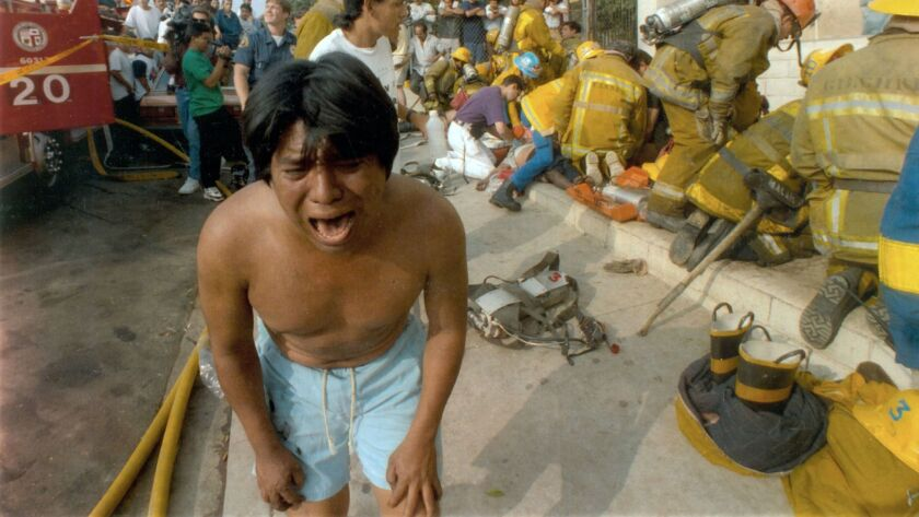 LA-ME-CALIFORNIA-RETROSPECTIVE -- File photo - May 3, 1993 -- A young man weeps after seeing a dead