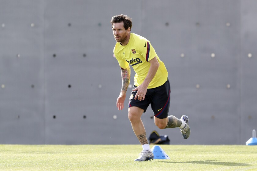 In this photo provided by FC Barcelona, Lionel Messi trains in Barcelona, Spain, on Friday May 8, 2020. Soccer players in Spain returned to train for the first time since the country entered a lockdown nearly two months ago because of the coronavirus pandemic. (Miguel Ruiz/FC Barcelona via AP)