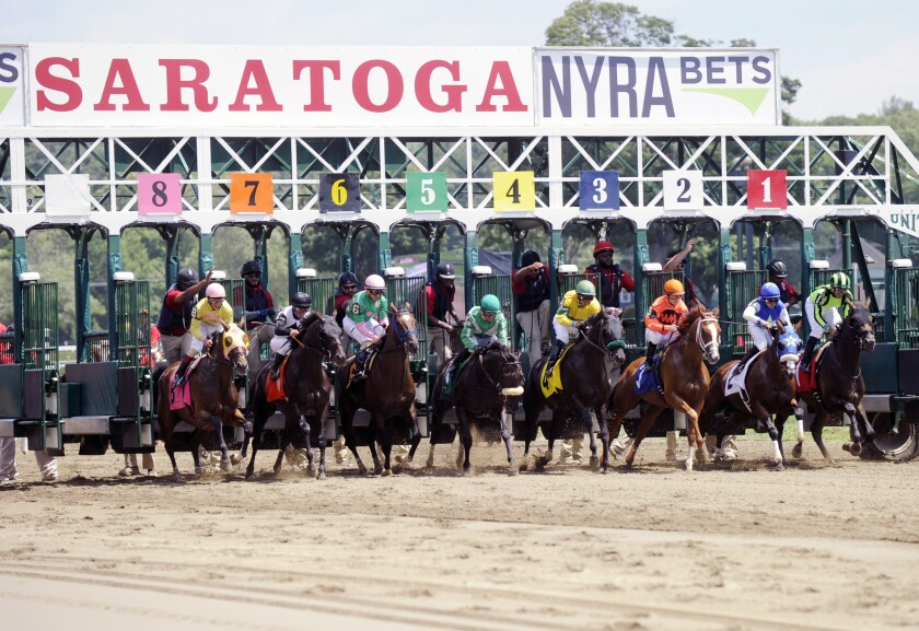 Horses break from the starting gate at Saratoga Race Course on July 22.