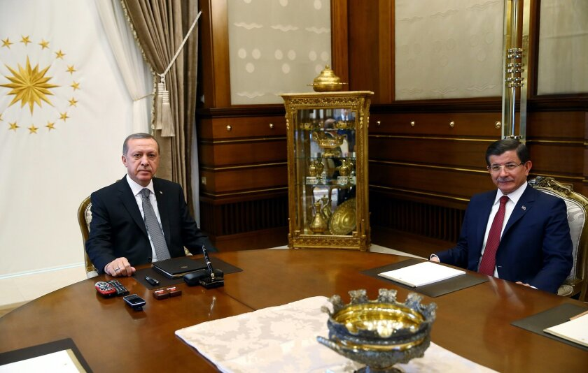 Turkish President Recep Tayyip Erdogan, left, and Prime Minister Ahmet Davutoglu attend a meeting at the presidential palace in Ankara, Turkey, Tuesday, Nov. 3, 2015. Turkish President Erdogan on Monday hailed a big victory for his ruling party in the country's parliamentary election and demanded t