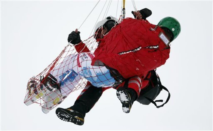 Austria's Klaus Kroell is airlifted to a hospital after crashing during the men's alpine skiing super-G World Cup race in Lenzerheide, Switzerland,Thursday, March 14, 2013. (AP Photo/Shinichiro Tanaka)