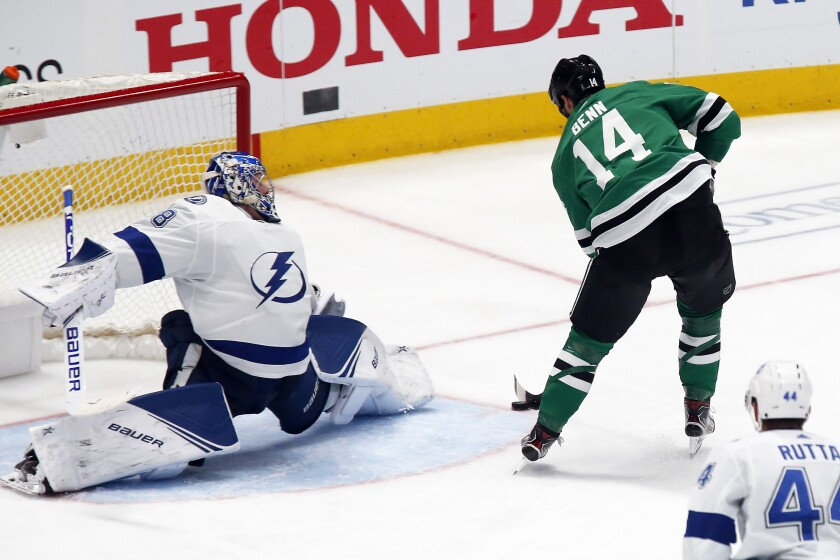 FILE - In this Jan. 27, 2020, file photo, Dallas Stars left wing Jamie Benn, right, backhandsa shot past Tampa Bay Lightning goaltender Andrei Vasilevskiy, left, for a goal during the third period of an NHL hockey game in Dallas. Two of the southernmost teams in the NHL are meeting in the Stanley Cup Final in the great white north. The Stars and the Lightning are facing off in the bubble in Edmonton, Alberta, starting with Game 1 Saturday. (AP Photo/Ray Carlin, File)