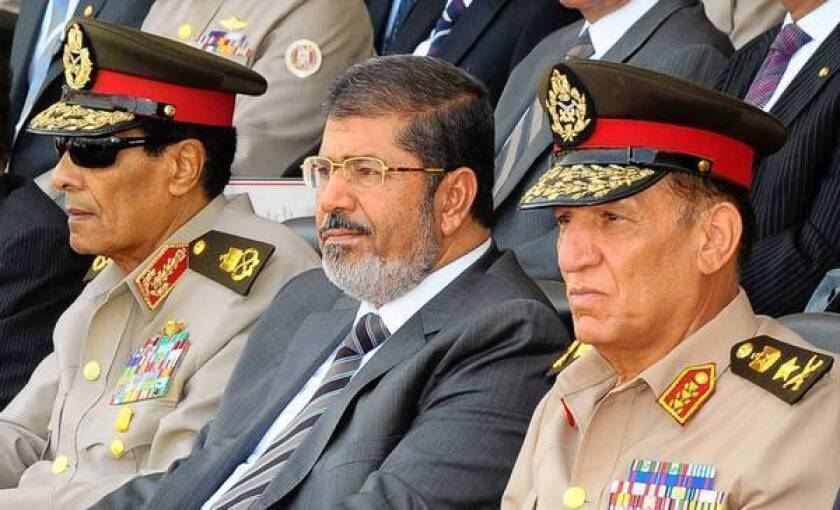 Amid Egypt president-army struggle, it's unclear who's in charge