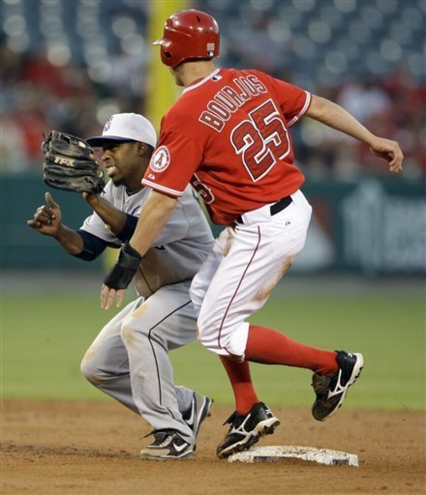 The Los Angeles Angels' Peter Bourjos steals second base ahead of the tag of Seattle Mariners shortstop Chone Figgins in the third inning of a baseball game in Anaheim, Calif., Saturday, Sept. 11, 2010. (AP Photo/Reed Saxon)