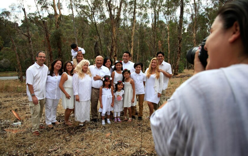 Four generations of the Dolopo family gather for a portrait this month at Morley Field with photographer Alina Mendoza. Misael Virgen • U-T