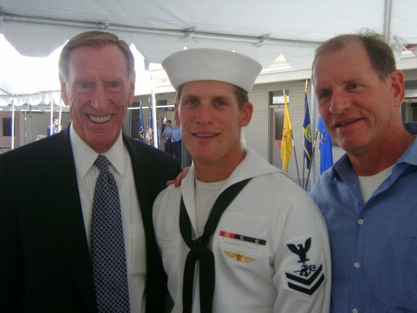 Charles Humphrey Keating IV at his Navy SEAL graduation in 2008. At left was his grandfather Charles Keating Jr., and at right was his father, Charles Keating III. / photo courtesy of Liz Keating