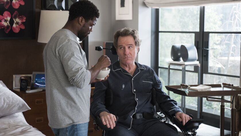 """Kevin Hart, left, and Bryan Cranston in the movie """"The Upside."""""""