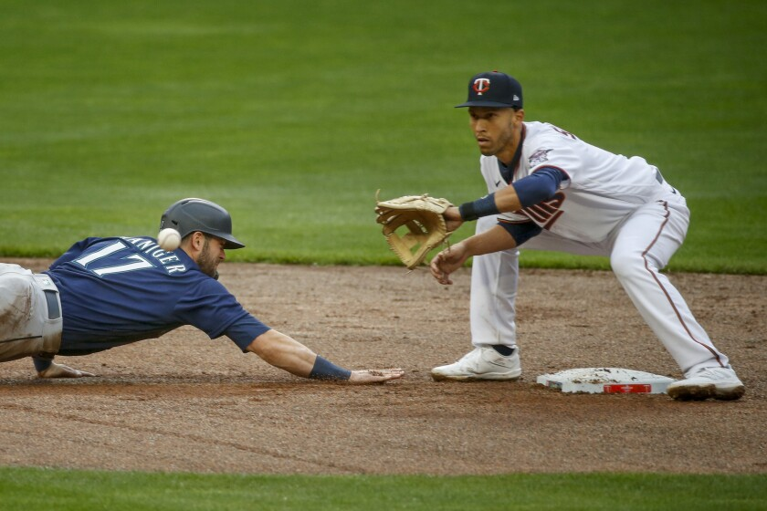 Minnesota Twins' Andrelton Simmons catches Seattle Mariners' Mitch Haniger off second base in the fifth inning of a baseball game Thursday, April 8, 2021, in Minneapolis. The Twins won 10-2. (AP Photo/Bruce Kluckhohn)