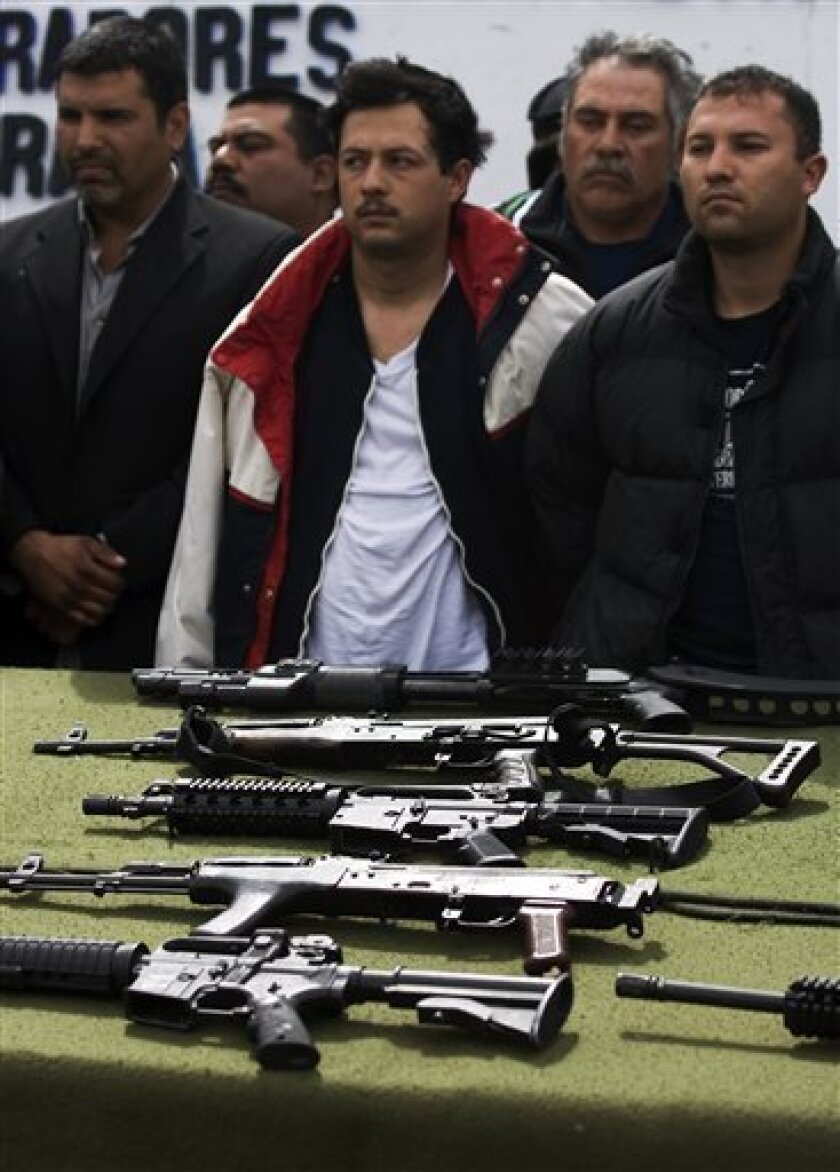 Suspected members of criminal gangs are presented to the media in Tijuana, Mexico, Monday, March 9, 2009. Mexico's cartels are losing their grip on the prized U.S. drug market, largely because of a cross-border crackdown and a regional shift in worldwide cocaine consumption.(AP Photo/Guillermo Aria