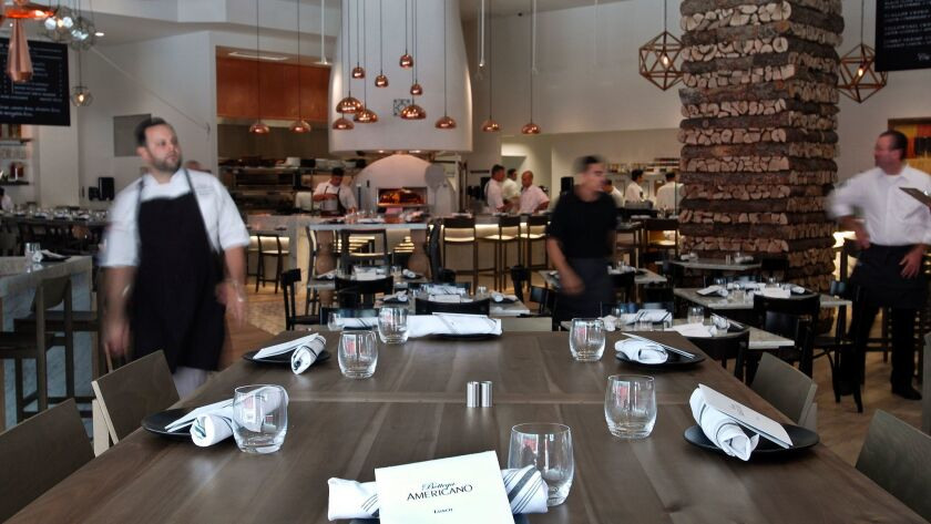 2014.09.04 -- A blur of acticivity from the waiters of Bottega Americano as they prepare for the lun