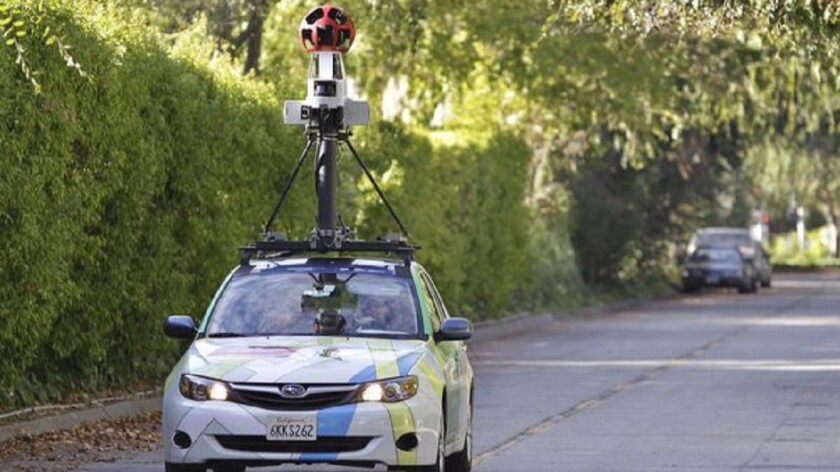 A Google employee drives a Street View car around Palo Alto, Calif.