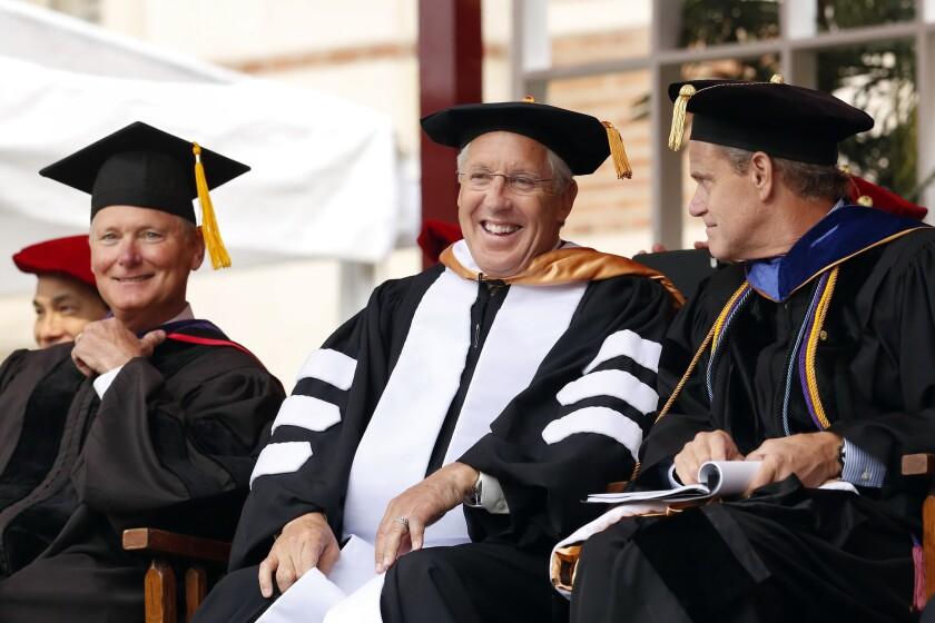 Former USC football coach Pete Carroll is beaming after receiving his honorary degree during USC commencement ceremonies on Friday.