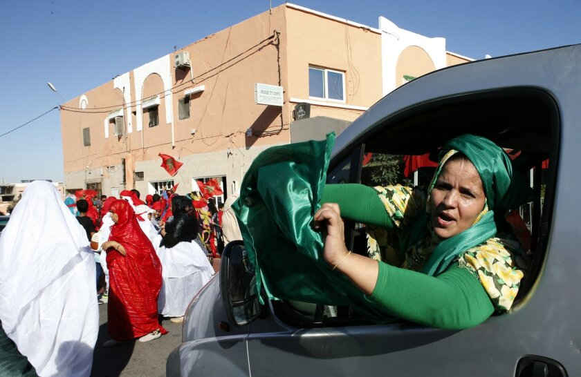 Moroccan women parade in a street of Laayoune, the capital of disputed territories of the Western Sahara, Friday, Nov.6, 2015. Morocco's King Mohammed VI visits the Western Sahara Friday to mark the 40th anniversary of the Green March, when thousands of unarmed Moroccans were sent by his father, la