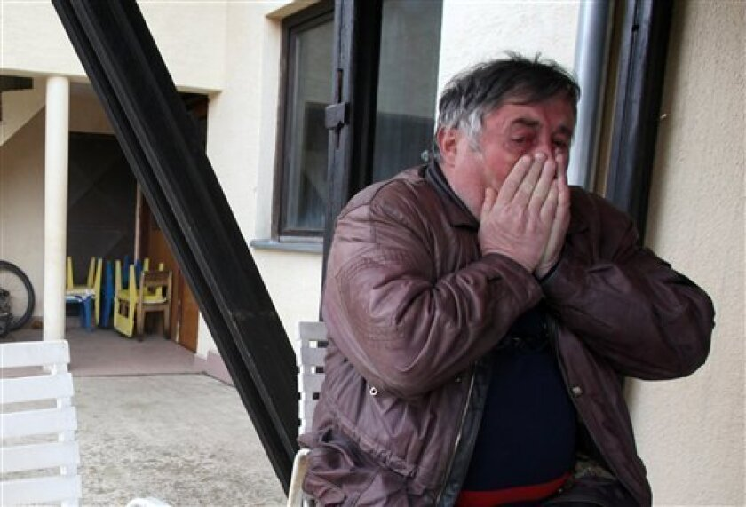 Radmilo Bogdanovic, brother of Ljubisa Bogdanovic cries in village of Velika Ivanca, Serbia, Tuesday, April 9, 2013. Ljubisa Bogdanovic a 60-year-old man gunned down 13 people, including a baby, in a house-to-house rampage in a quiet village on Tuesday before trying to kill himself and his wife, po