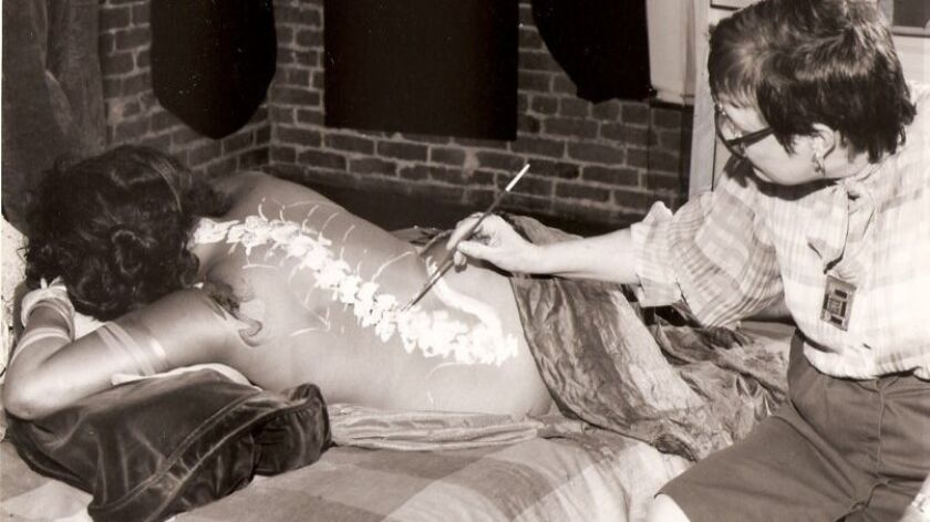 Eleanor Creekmore Dickinson paints a model as part of a fundraiser for a museum in 1983.