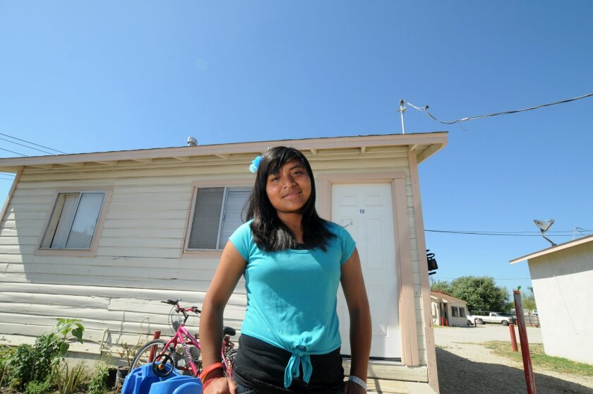 Alondra Mendoza, 16, lives in a two-room house set into dirt in El Rio, a predominantly Latino neighborhood. She has spoken to the school board as part of Tequio's No me llames Oaxqauita campaign. CREDIT: Carlos Puma/The Center for Investigative Reporting