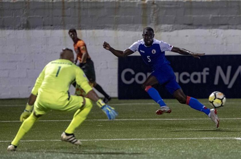 Nicaraguan goalkeeper Justo Lorente prepares to deal with a shot by Haiti's Carteris Arcus during a Concacaf Nations League match in Managua on Saturday, Nov. 17. EFE-EPA/Jorge Torres