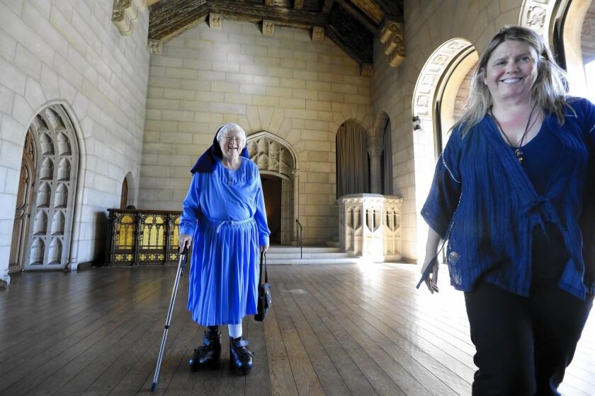 Sister Rita Callanan, 77, left, and restaurateur Dana Hollister walk inside the main room of a villa at the former convent in Los Feliz.
