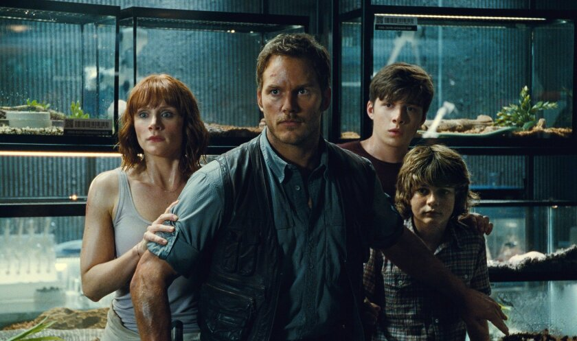 """Bryce Dallas Howard, from left, Chris Pratt, Nick Robinson and Ty Simpkins appear in a scene from the blockbuster hit """"Jurassic World."""" The film was the No.1 movie of summer 2015, the second-highest grossing summer to date."""