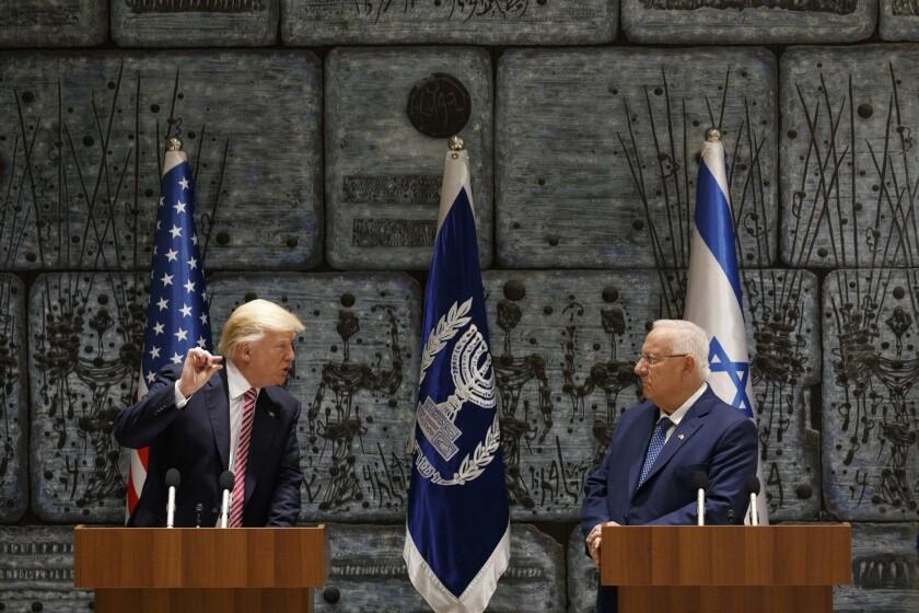 Israeli President Reuven Rivlin listens as President Trump speaks in Jerusalem in May.