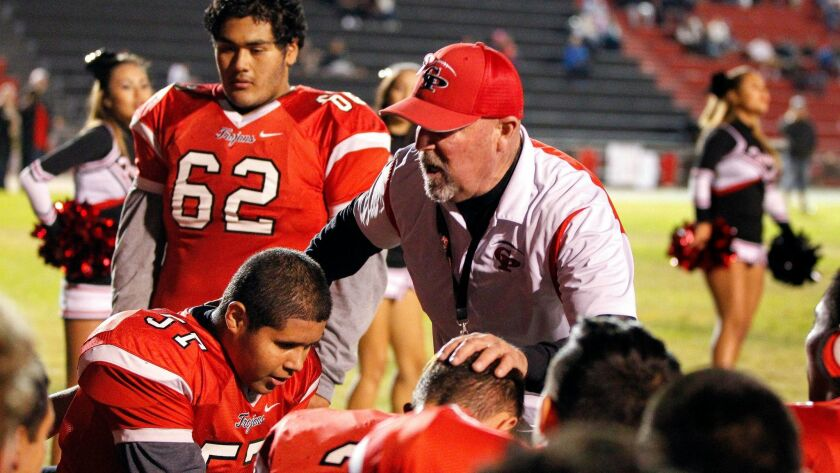 Castle Park head coach Hans Graham talks to his players prior to their game against Monte Vista.