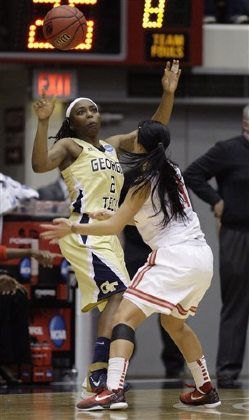 Ohio State's Samantha Prahalis, right, knocks the ball away from Georgia Tech's Metra Walthour during the first half of a second-round NCAA women's college basketball tournament game Monday, March 21, 2011, in Columbus, Ohio. (AP Photo/Jay LaPrete)