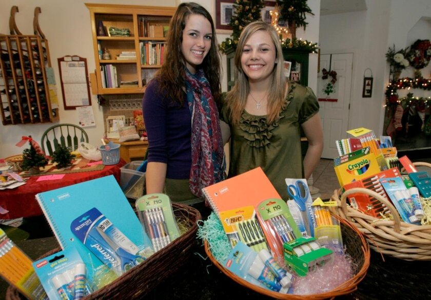 San Pasqual High juniors Lexi Wilhelm (left) and Erin Morgan, both 16, are Girl Scouts working to raise awareness about hunger in Africa.