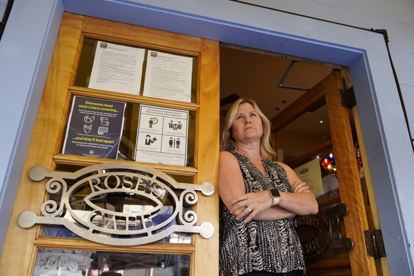 Laurie Thomas poses by an entryway to her Rose's Cafe restaurant, Sept. 28, 2020, in San Francisco.