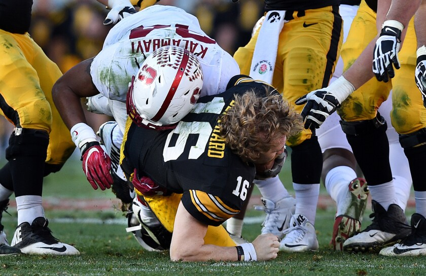 Iowa quarterback C.J. Beathard loses his helmet as he's sacked by Stanford linebacker Peter Kalambayi in the second quarter.