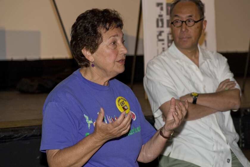 Pompea Smith, longtime manager of the Hollywood farmers market, and executive director of Sustainable Economic Enterprises of Los Angeles (SEE-LA), the nonprofit group that runs the Hollywood farmers market and seven others, has been fired by the board, say sources on and close to the board. Here she spoke at a public meeting concerning the market's dispute with the Los Angeles Film School, at the Montalbán Theatre in Hollywood. Michael Woo, SEE-LA's chairman, is at right.